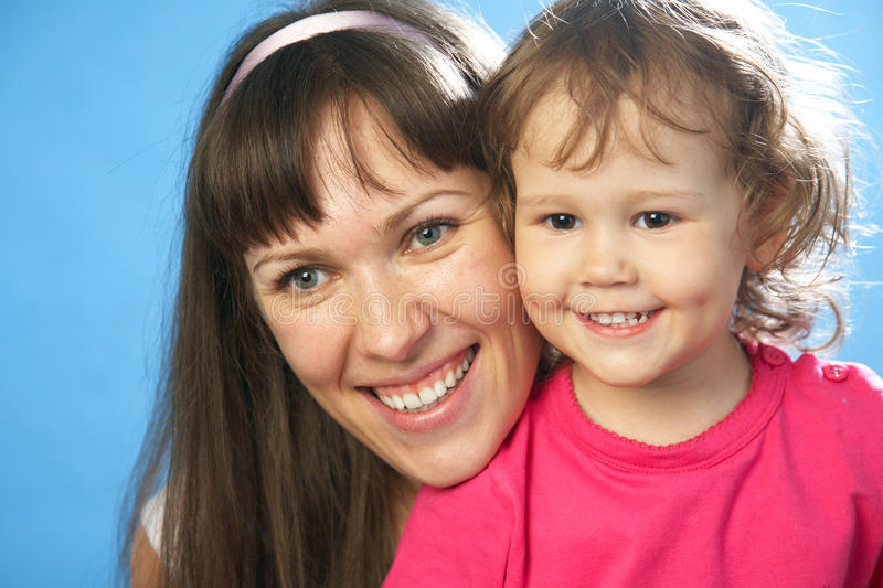 Portrait of young mother with her daughter royalty free stock photos