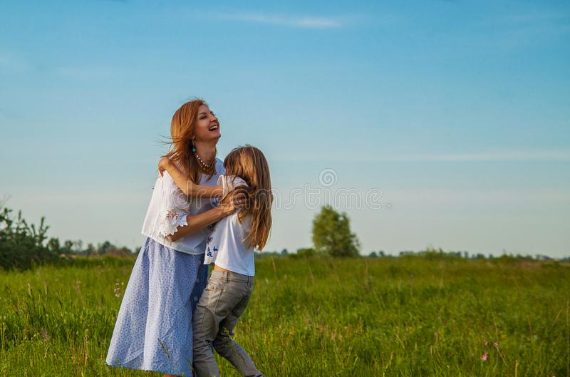 Happy family mother and daughter hugging in summer on the nature. Healthy lifestyle concept. stock image