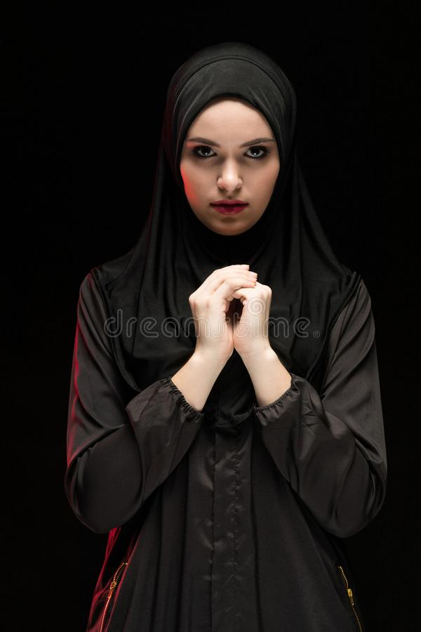 Portrait of young Muslim woman in traditional clothes stock image
