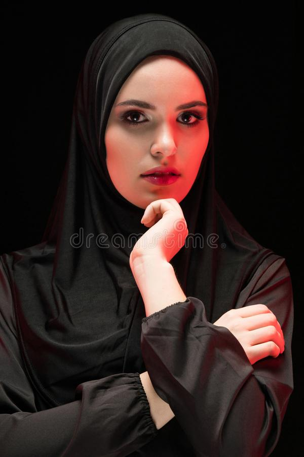 Portrait of young Muslim woman in traditional clothes royalty free stock image