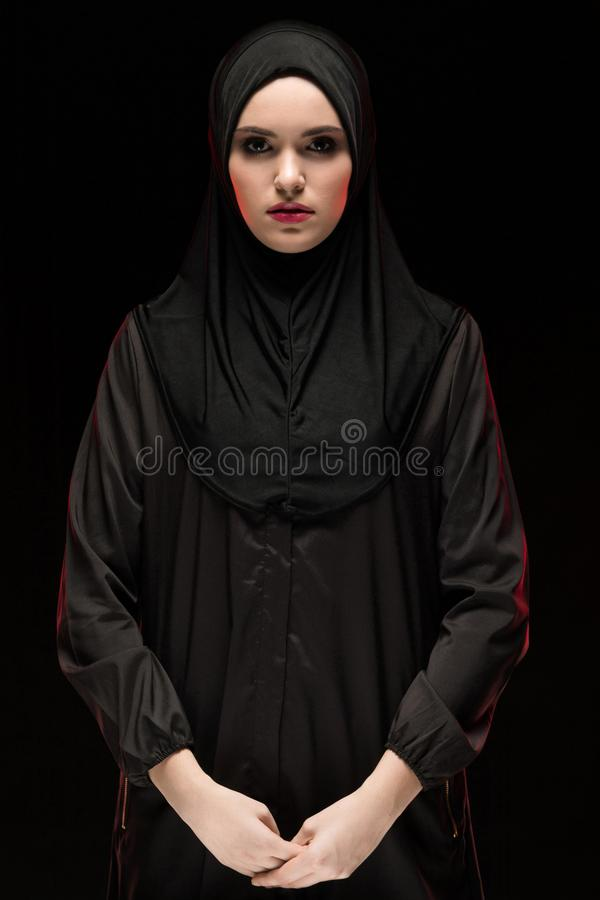 Portrait of young Muslim woman in traditional clothes stock photo