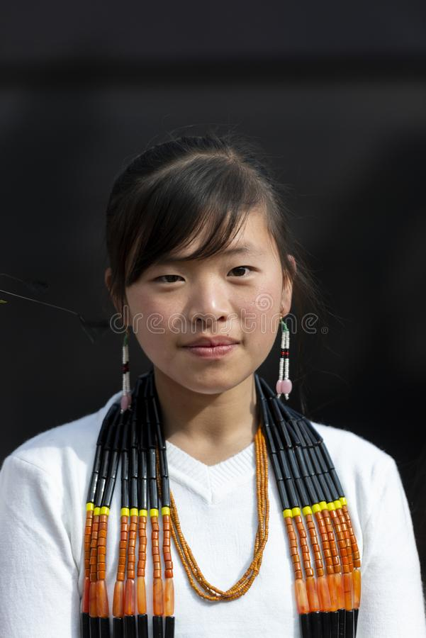 Portrait of a Young Naga Lady during Hornbill Festival,Nagaland,India stock photography