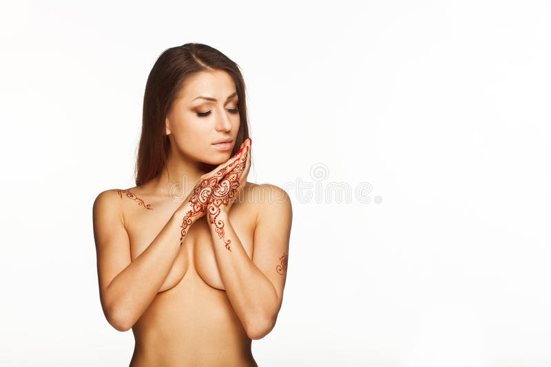 Portrait of young naked girl with mehendi on wrists and back royalty free stock photo