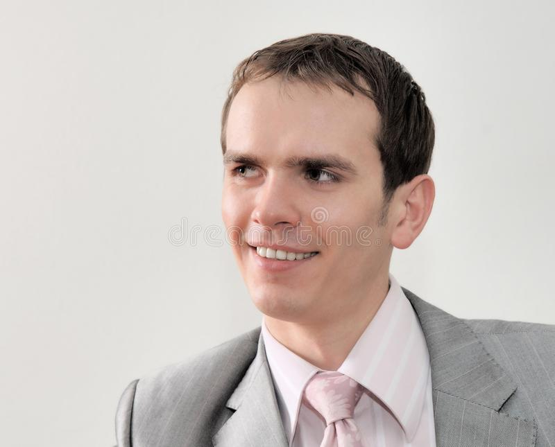 Portrait of young nice businessman on white background stock photo