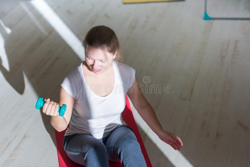 Portrait of young obese woman working out home royalty free stock image