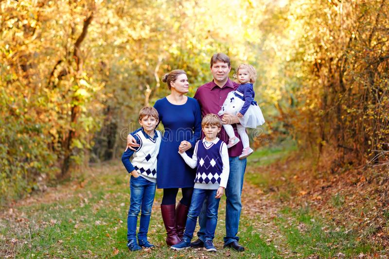 Portrait of young parents with three children. Mother, father, two kids brothers boys and little cute toddler sister stock image