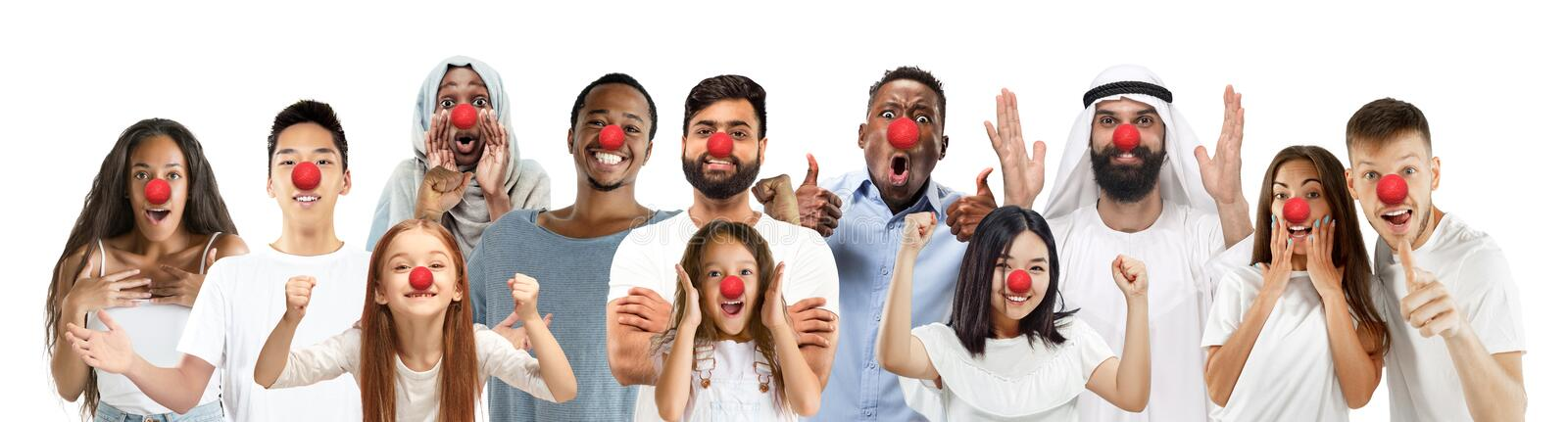 Portrait of young people celebrating red nose day on white background stock photos