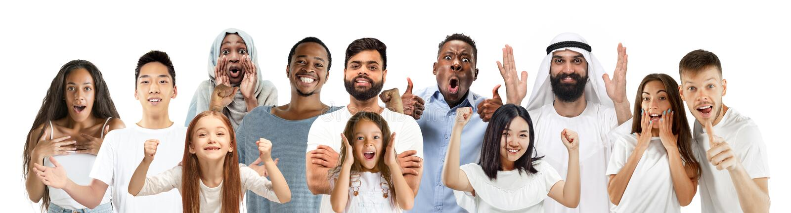 Portrait of young people looks astonished and happy on white background stock image