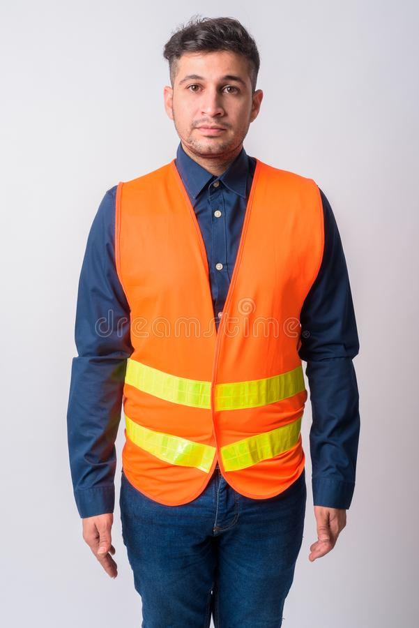 Portrait of young Persian man construction worker royalty free stock photos