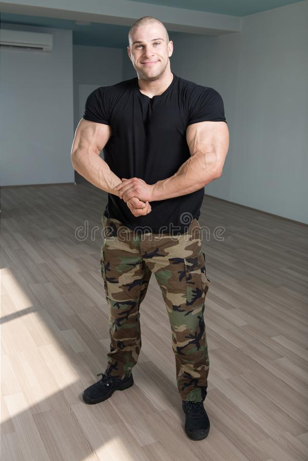 Portrait Of A Muscular Man In Army Pants. Portrait Of A Young Physically Fit Man Showing His Well Trained Body In Army Pants - Muscular Athletic Bodybuilder royalty free stock photo