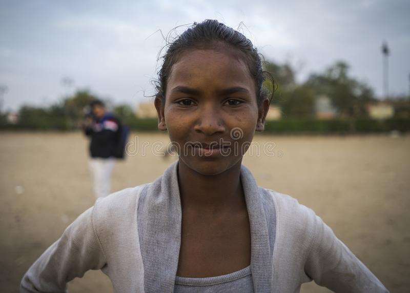 Portrait of young poor girl in India. Jaipur, Rajasthan / India - 03 24 2019, Portrait of young girl, Poor kid in the slum area of the city stock photography