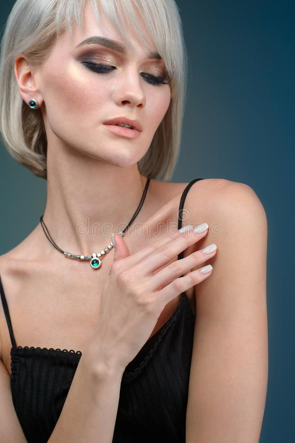 Portrait young pretty blond woman in luxury jewelry, lifestyle rich people concept, close up stock photos