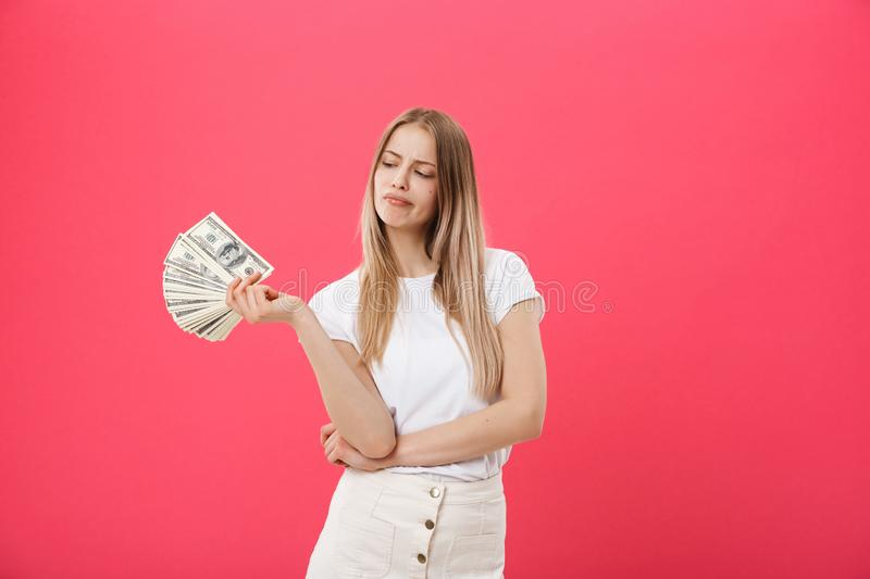Portrait of young pretty blonde woman against a pink background very angry and upset, very tense, screaming furious royalty free stock images