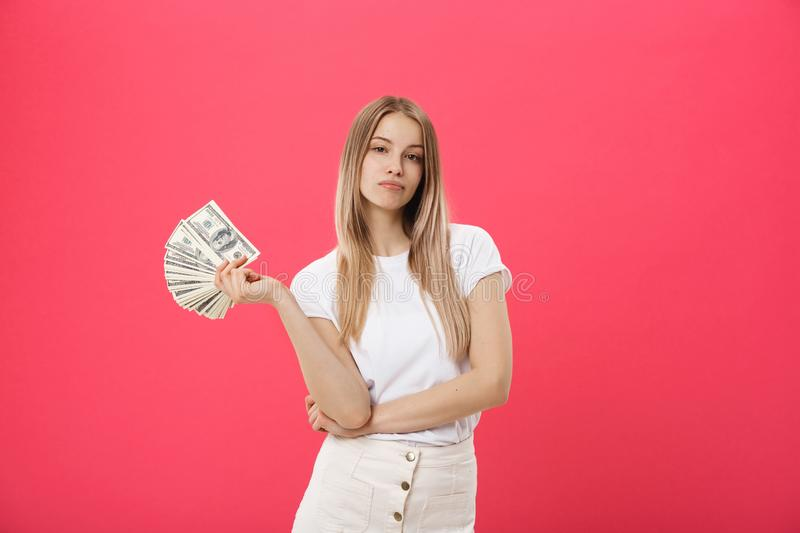 Portrait of young pretty blonde woman against a pink background very angry and upset, very tense, screaming furious royalty free stock image