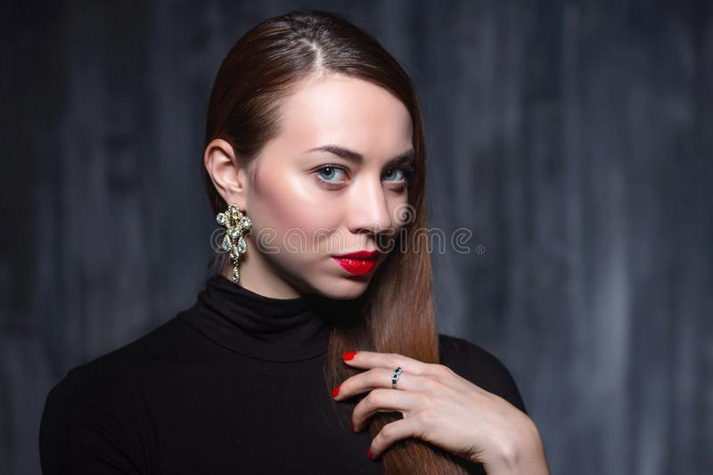 Portrait of a young pretty brunette royalty free stock image