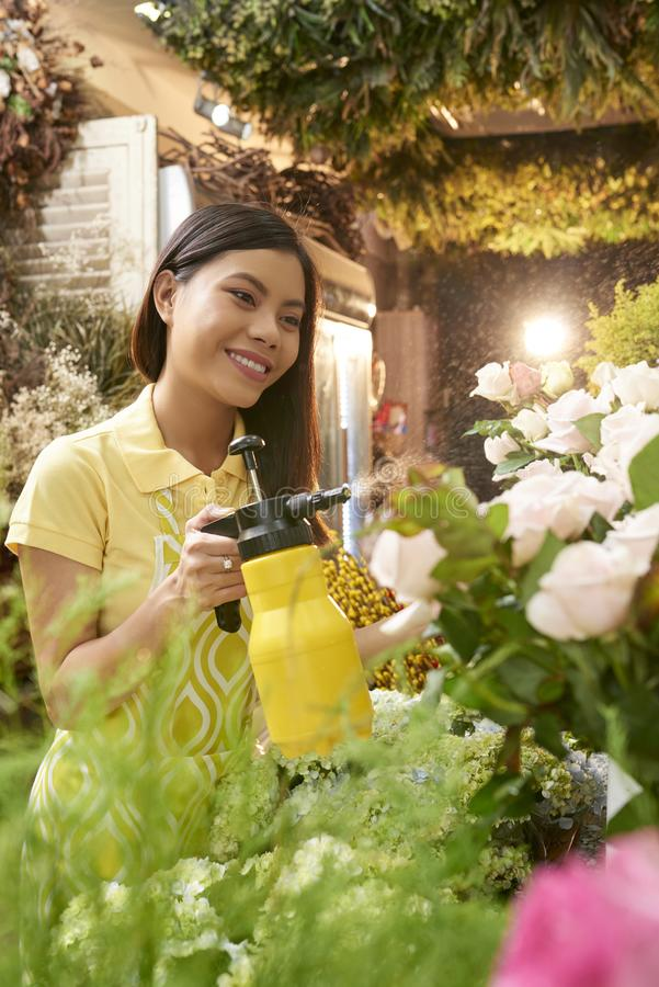 Pretty florist busy with work royalty free stock photography