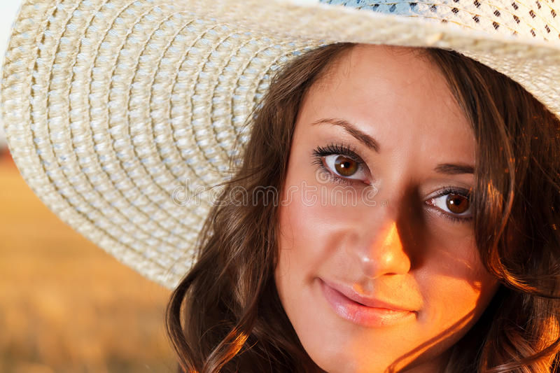 Portrait of young pretty girl dressed in bright hat stock photo