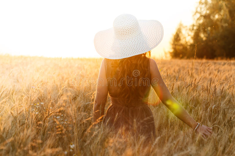 Portrait of young pretty girl dressed in bright hat royalty free stock photo