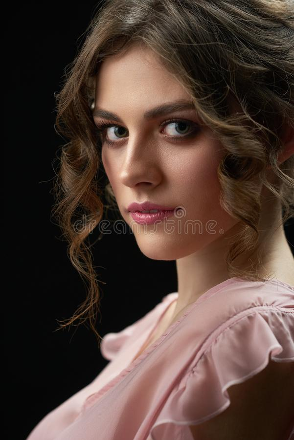 Portrait of a young pretty girl looking at camera. stock photos