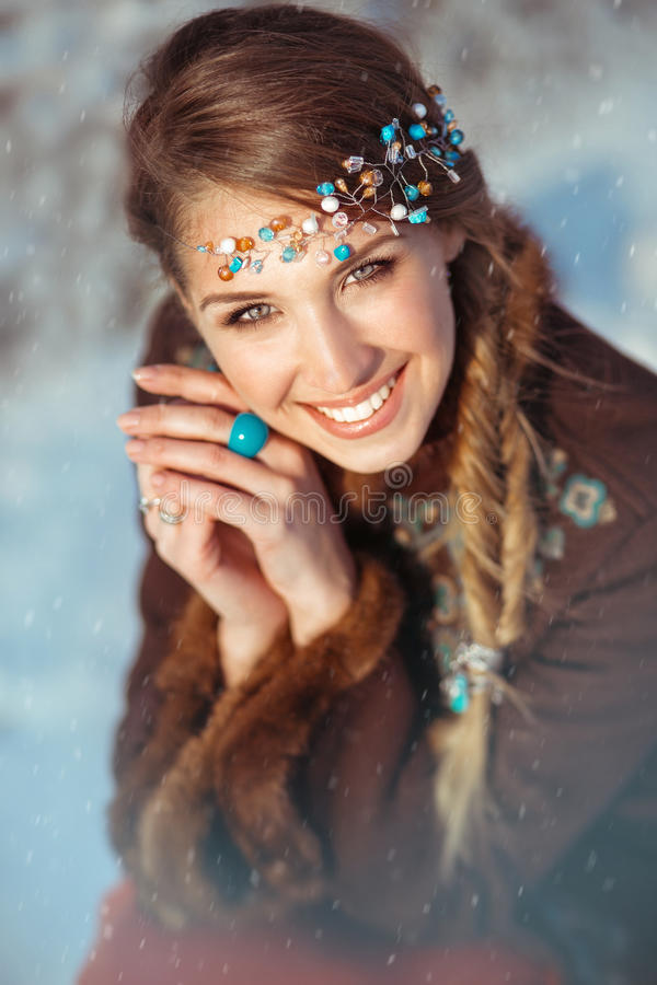 Portrait of the young pretty girl with a tiara royalty free stock photography
