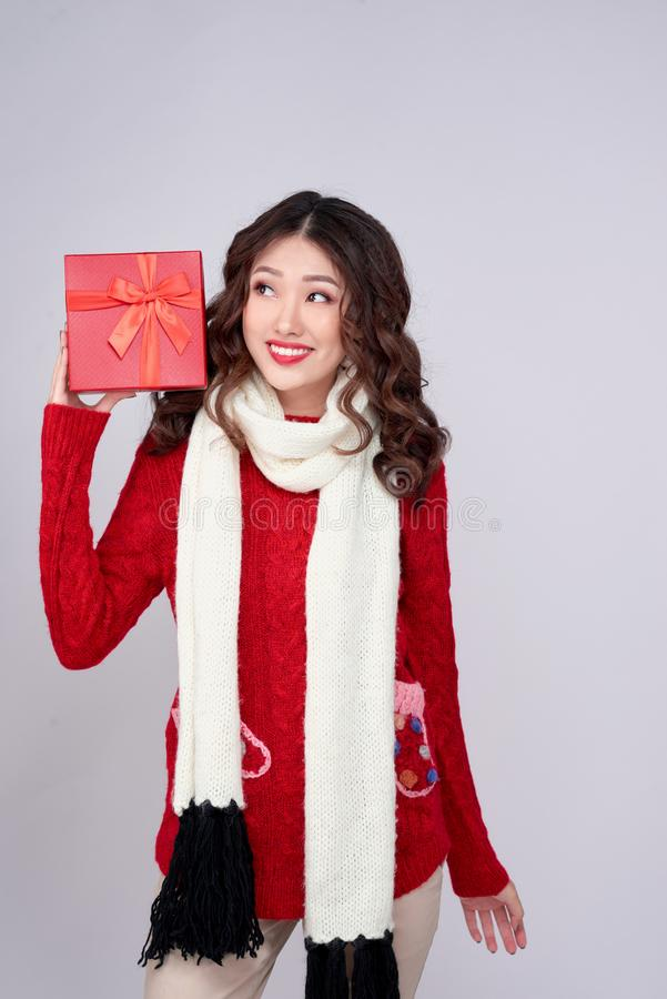 Portrait of young, pretty and happy woman with christmas gift box stock photos
