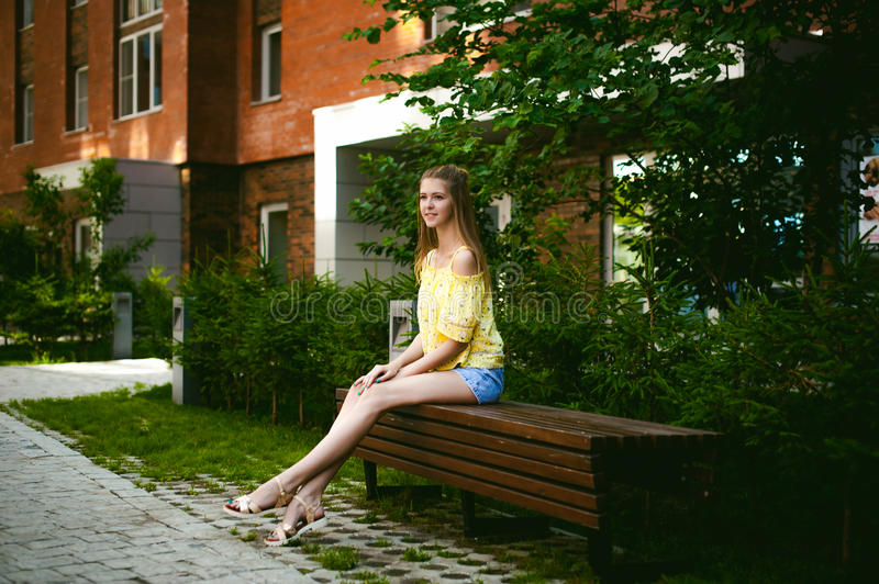 Young beautiful woman, warm summer sunny day stock photo
