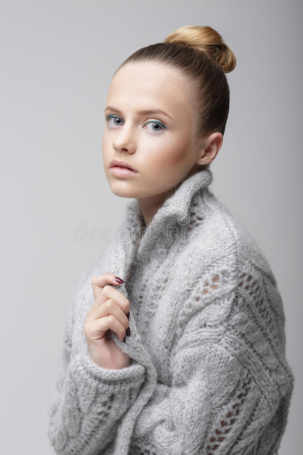 Portrait of Young Pretty Woman in Knitted Woolen Gray Jersey royalty free stock photos