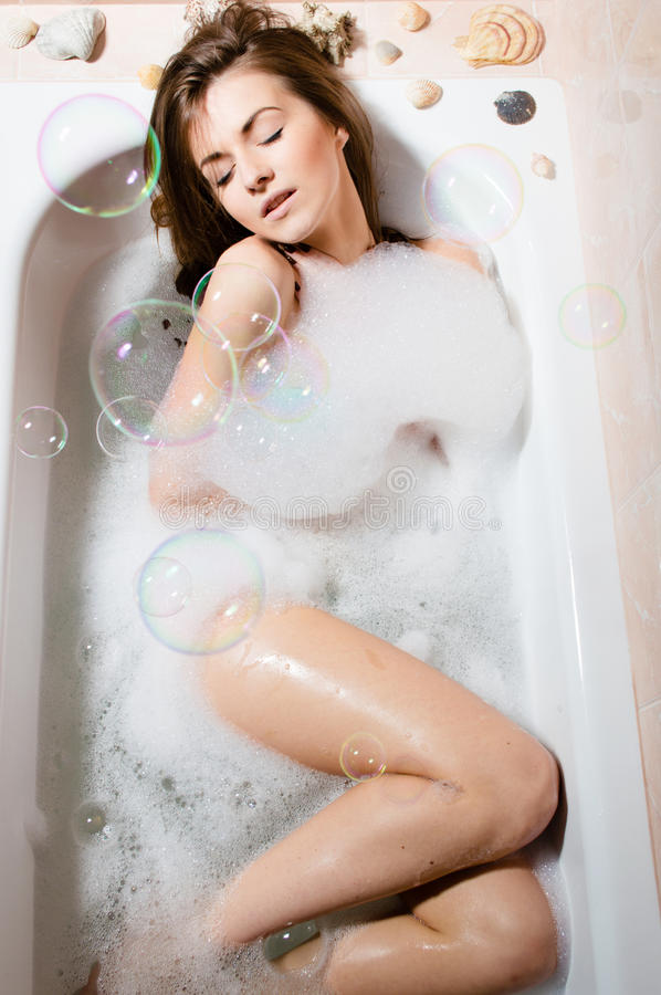 Download Portrait Of Young Pretty Woman Relaxing In Bath With Foam Stock Photo