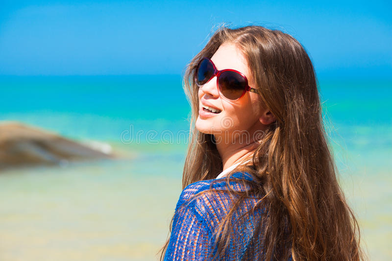 Portrait of young pretty woman in sunglasses and royalty free stock image