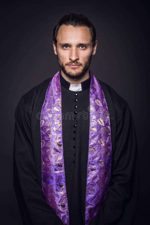 Portrait of young priest royalty free stock image