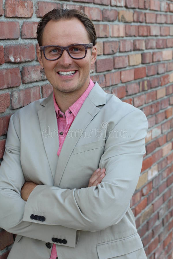 Portrait of young professional entrepreneur smiling. Confident, happy, and successful stock image