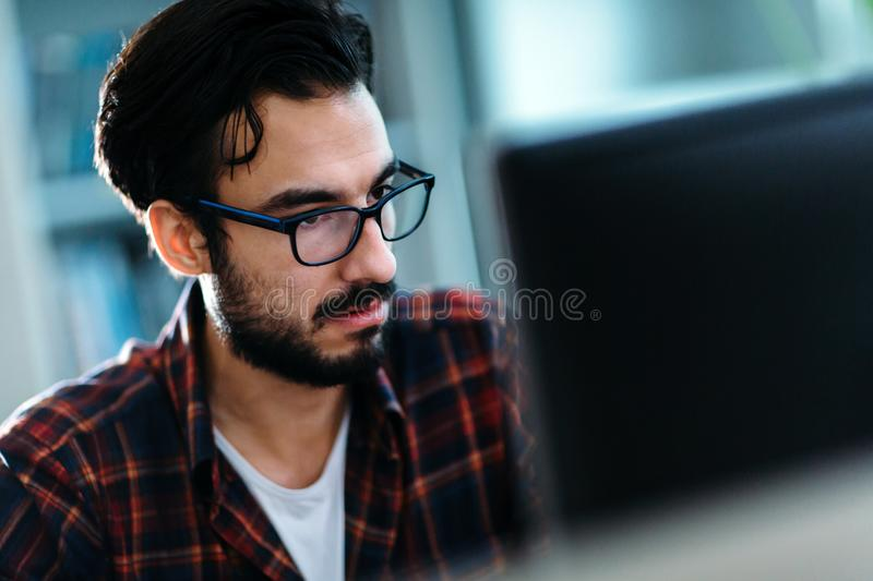 Portrait of young programmer working in office stock photo