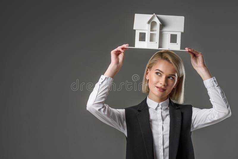 portrait of young real estate agent with house model royalty free stock image