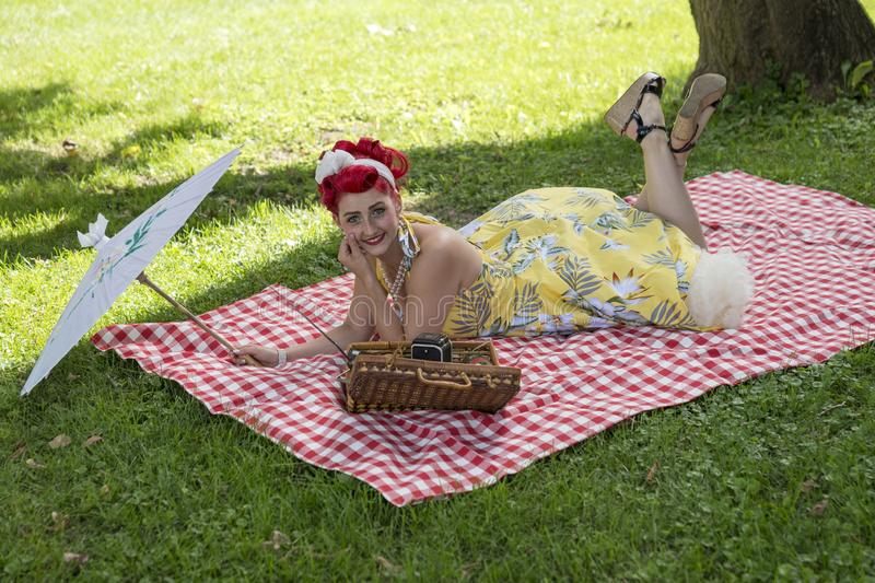 Retro woman style pinup in picnic stock images