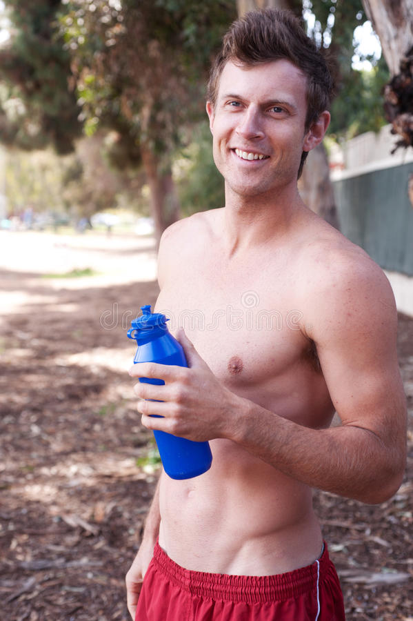Portrait of a young runner with water bottle royalty free stock photo