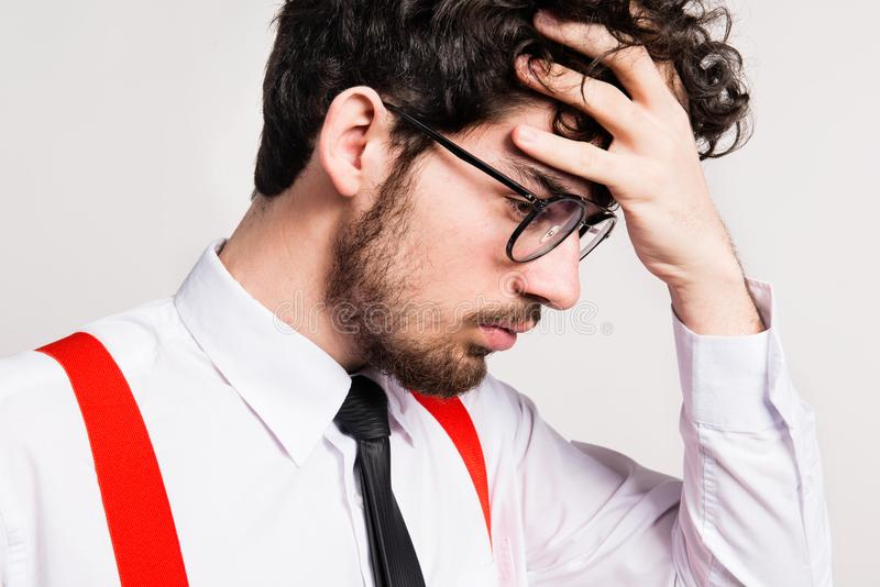 Portrait of a young sad and worried man in a studio. stock photography