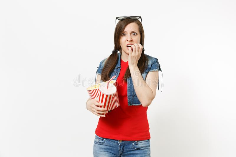 Portrait of young scared woman in 3d imax glasses gnawing nails watching movie film, holding bucket of popcorn and. Portrait of young scared woman in 3d glasses royalty free stock image
