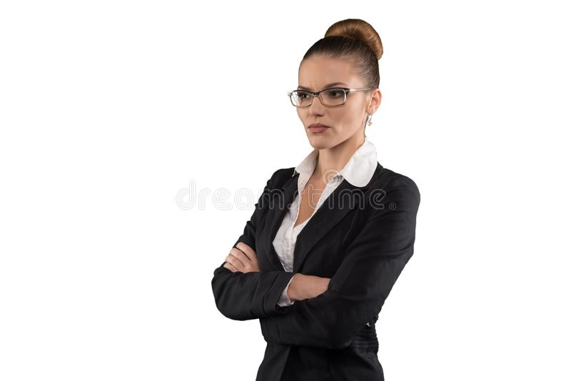 Beautiful serious business woman with glasses and crossed arms isolated on white stock photos