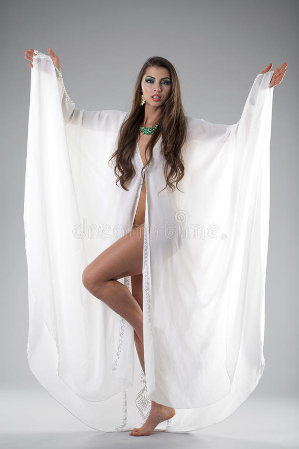 Portrait of the young woman in a white tunic Arabic stock image