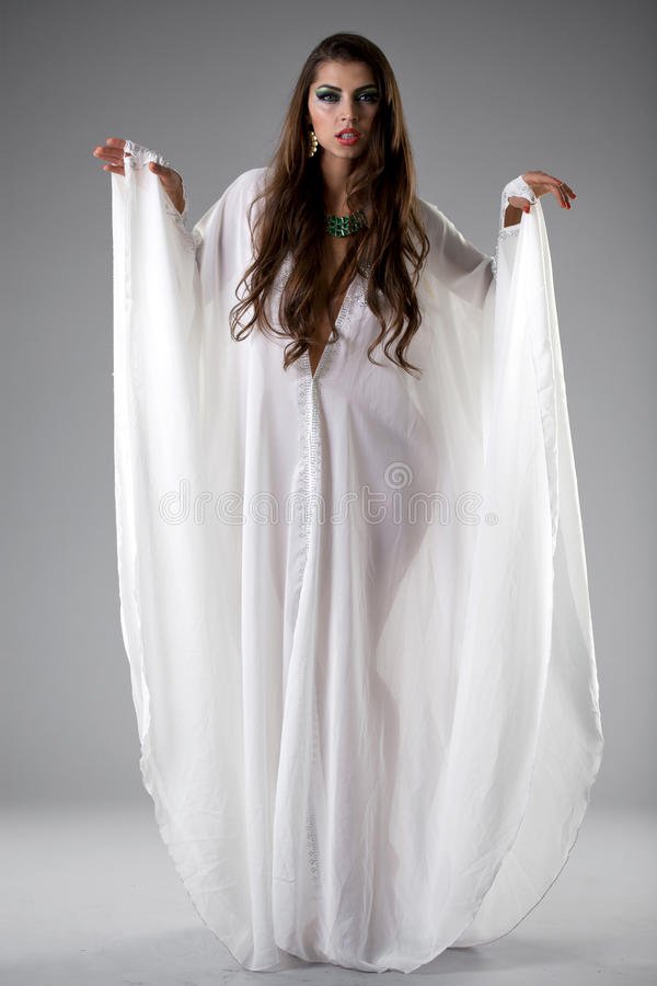 Portrait of the young woman in a white tunic Arabic royalty free stock photography