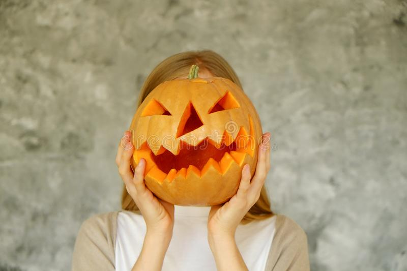 Halloween themed image with carved pumpkins in house party environment. stock photos