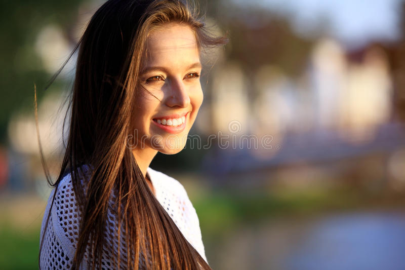 Portrait Of Young Smiling Beautiful Woman. Close-up portrait of a fresh and beautiful young fashion model posing outdoor. Summer outdoor portrait royalty free stock photos
