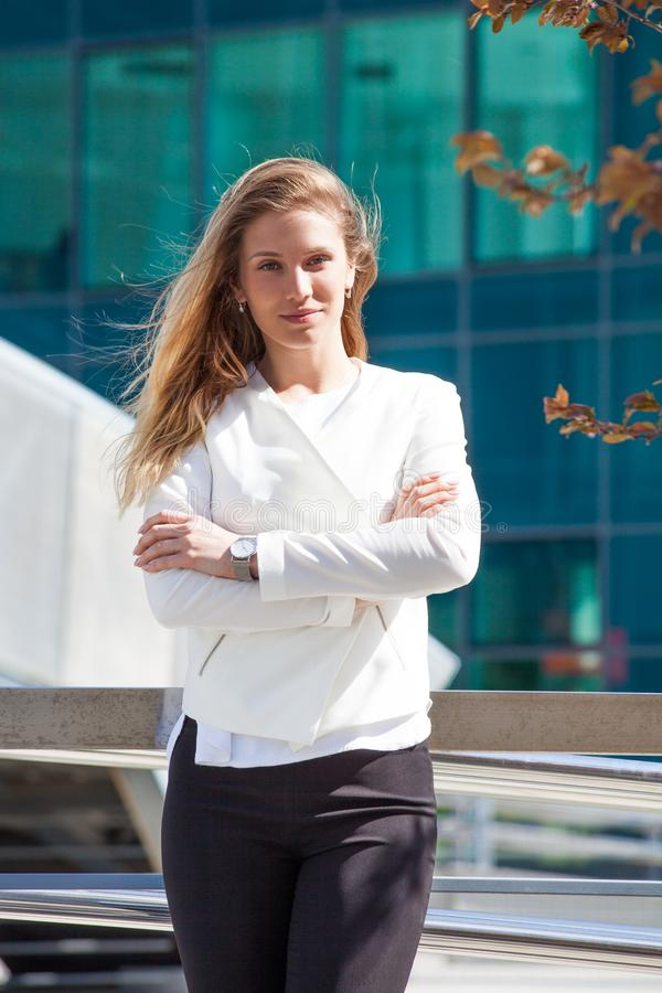 Portrait of young smiling business woman outdoor in the city royalty free stock image