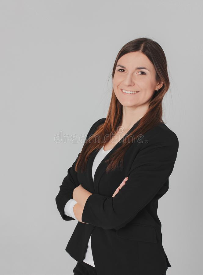 Portrait of young smiling brunette woman lady in business suit i stock image