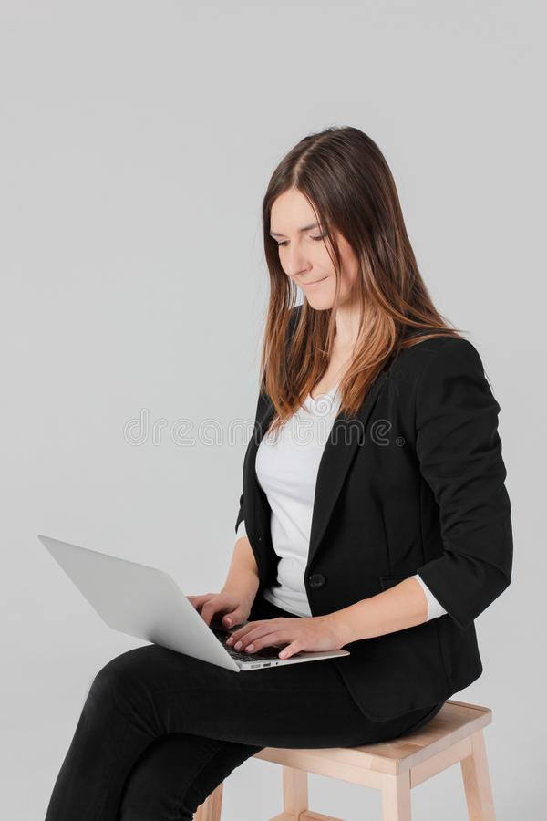 Portrait of young smiling brunette woman lady in business suit w stock photo