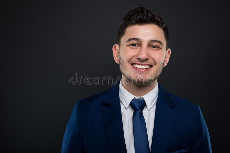 Portrait of young smiling businessman stock photo