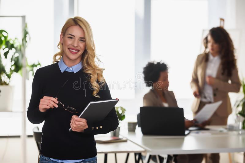 Portrait of a young smiling businesswoman in diverse women`s creative office stock photos