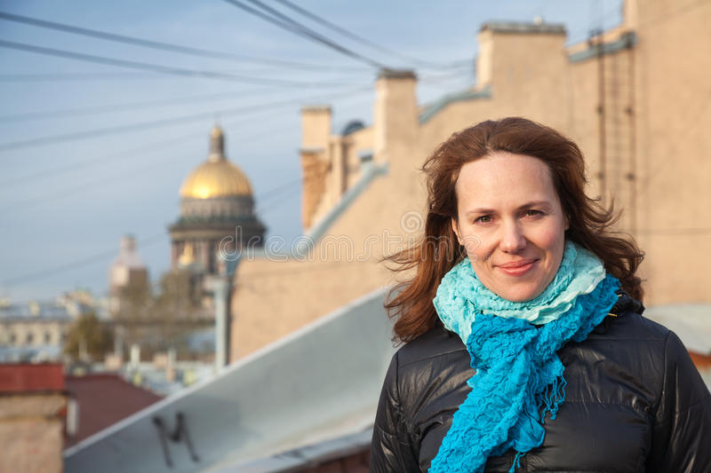 Portrait of young smiling Caucasian woman on the rooftop royalty free stock photography