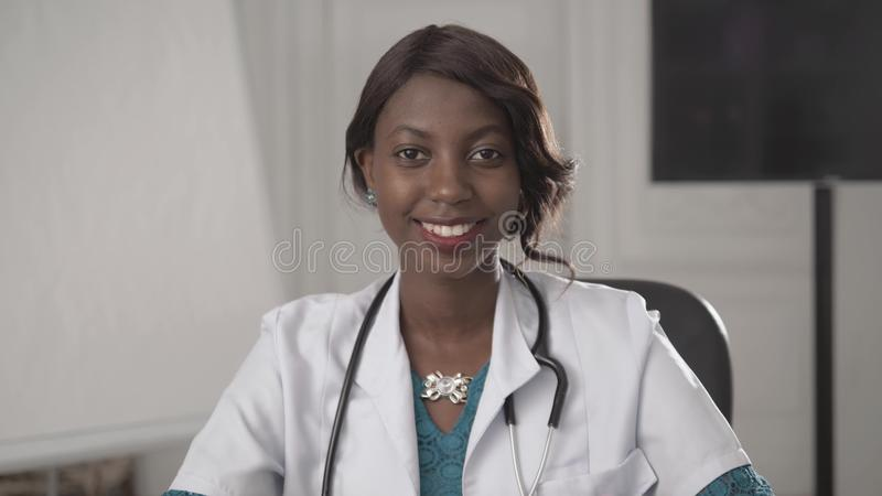 Portrait of a young smiling black african american doctor. royalty free stock photography