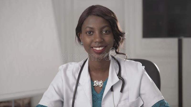 Portrait of a young smiling black african american doctor. stock photo